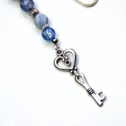 Lesezeichen blau mit einem Schlüssel