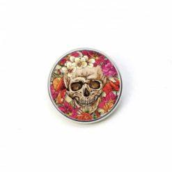 Druckknopf frühlingshafter Totenkopf mit Blumen in rot und rosa