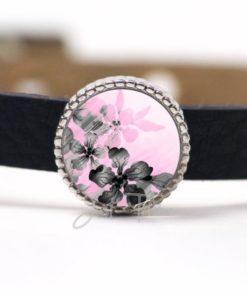 Schiebeperle mit einem grau / rosa Blumenmotiv