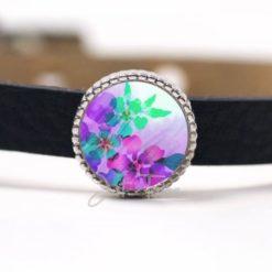 Schiebeperle mit einem violet / grünem Blumenmotiv