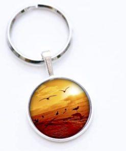 Schlüsselanhänger Vögel beim Sonnenuntergang